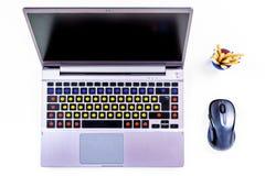 有意思号的膝上型计算机键盘,面带笑容 免版税库存图片