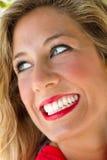 有意想不到的微笑的妇女 图库摄影