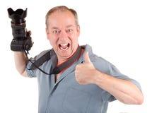 有成功男性照片摄影师的射击 免版税库存照片