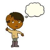 有成长的动画片男孩在有想法泡影的头 免版税图库摄影