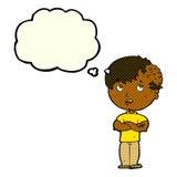 有成长的动画片男孩在有想法泡影的头 免版税库存图片