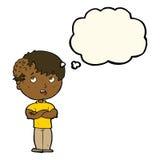有成长的动画片男孩在有想法泡影的头 库存照片