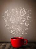 有手拉的厨房辅助部件的咖啡杯 免版税库存图片