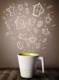 有手拉的厨房辅助部件的咖啡杯 免版税库存照片