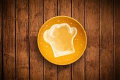 有手拉的白色厨师标志的五颜六色的板材 库存图片