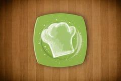有手拉的白色厨师标志的五颜六色的板材 图库摄影