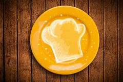 有手拉的白色厨师标志的五颜六色的板材 免版税库存图片