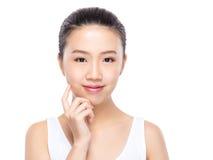 有手指接触的亚裔妇女在面孔 免版税库存照片
