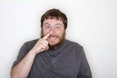 有手指的人他的鼻子 库存图片