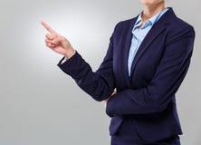 有手指的女实业家指出 免版税库存照片