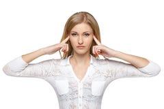 有手指的妇女在耳朵 库存图片