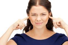 有手指的妇女在耳朵 免版税库存图片