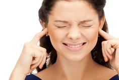 有手指的妇女在耳朵 免版税库存照片