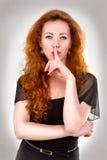有手指的妇女在嘴 免版税库存照片