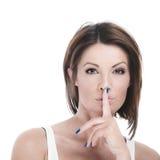 有手指的妇女对嘴唇 免版税库存照片