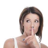 有手指的妇女对嘴唇 免版税库存图片