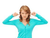 有手指的学员在耳朵 免版税库存图片