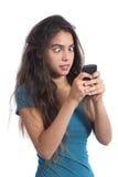 有手机技术的占据心思的少年女孩 免版税库存图片