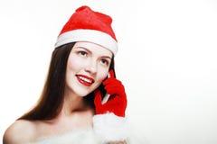 有手机的圣诞老人女孩 图库摄影