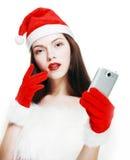 有手机的圣诞老人女孩 库存图片