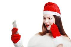 有手机的圣诞老人女孩 库存照片
