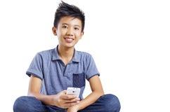有手机的少年 免版税库存照片