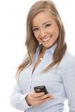 有手机的愉快的女孩 免版税库存图片