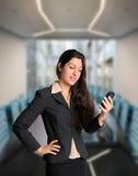 有手机的确信的女商人 库存照片