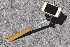 有手机的Selfie棍子 库存图片