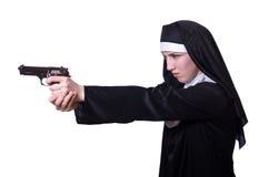 有手枪的尼姑 免版税库存照片