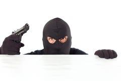 有手枪的窃贼 免版税库存照片