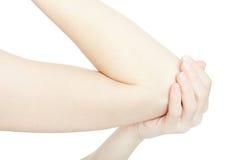 有手肘痛苦和手的在白色,裁减路线妇女胳膊 库存照片