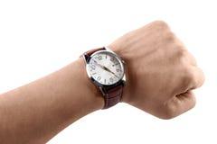 有手表的一只手,隔绝在白色背景 免版税库存图片