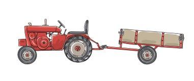 有打翻的手拉拖车的葡萄酒古色古香的拖拉机 免版税库存图片
