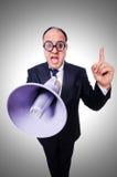 有扩音器的滑稽的人 免版税库存照片