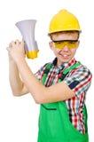 有扩音器的滑稽的建筑工人 库存照片