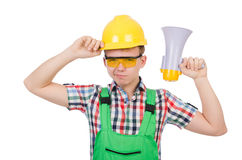 有扩音器的滑稽的建筑工人 免版税库存图片