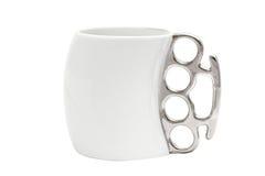 有把柄的一个杯子以指节铜环的形式 图库摄影