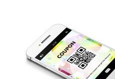 有折扣优惠券的手机在白色 库存照片