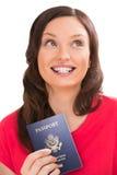 有护照的沉思正面妇女 免版税库存照片