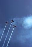 有抽烟的踪影的三架体育飞机 库存图片