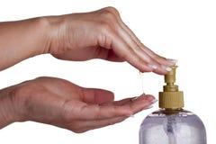 有抽的化妆水的手肥皂从瓶 免版税库存图片