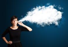 有抽象云彩的少妇 免版税库存图片