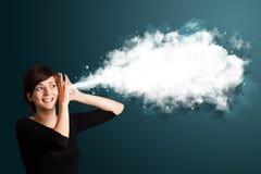 有抽象云彩的少妇 免版税库存照片