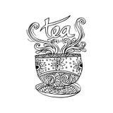 有抽象装饰品的茶杯 库存照片