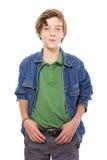 有拇指的微笑的十几岁的男孩在他的传送带,隔绝在白色 免版税图库摄影