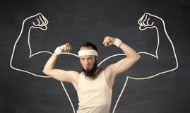有拉长的肌肉的年轻微弱的人 库存照片