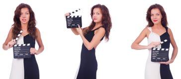 有拍板在白色隔绝的电影委员会的妇女 库存图片