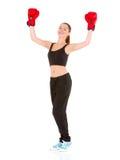 有拳击手套的美丽的运动的妇女 免版税库存图片