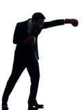 有拳击手套剪影的商人拳击手 免版税库存照片